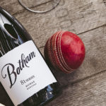 Botham Series 81 Series bottle with a cricket bat and cricket ball on a wine barrel
